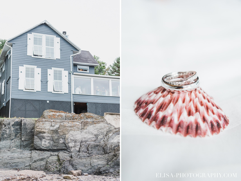 bague et alliances dans un coquillage et un domaine au bord de l'eau photo de mariage