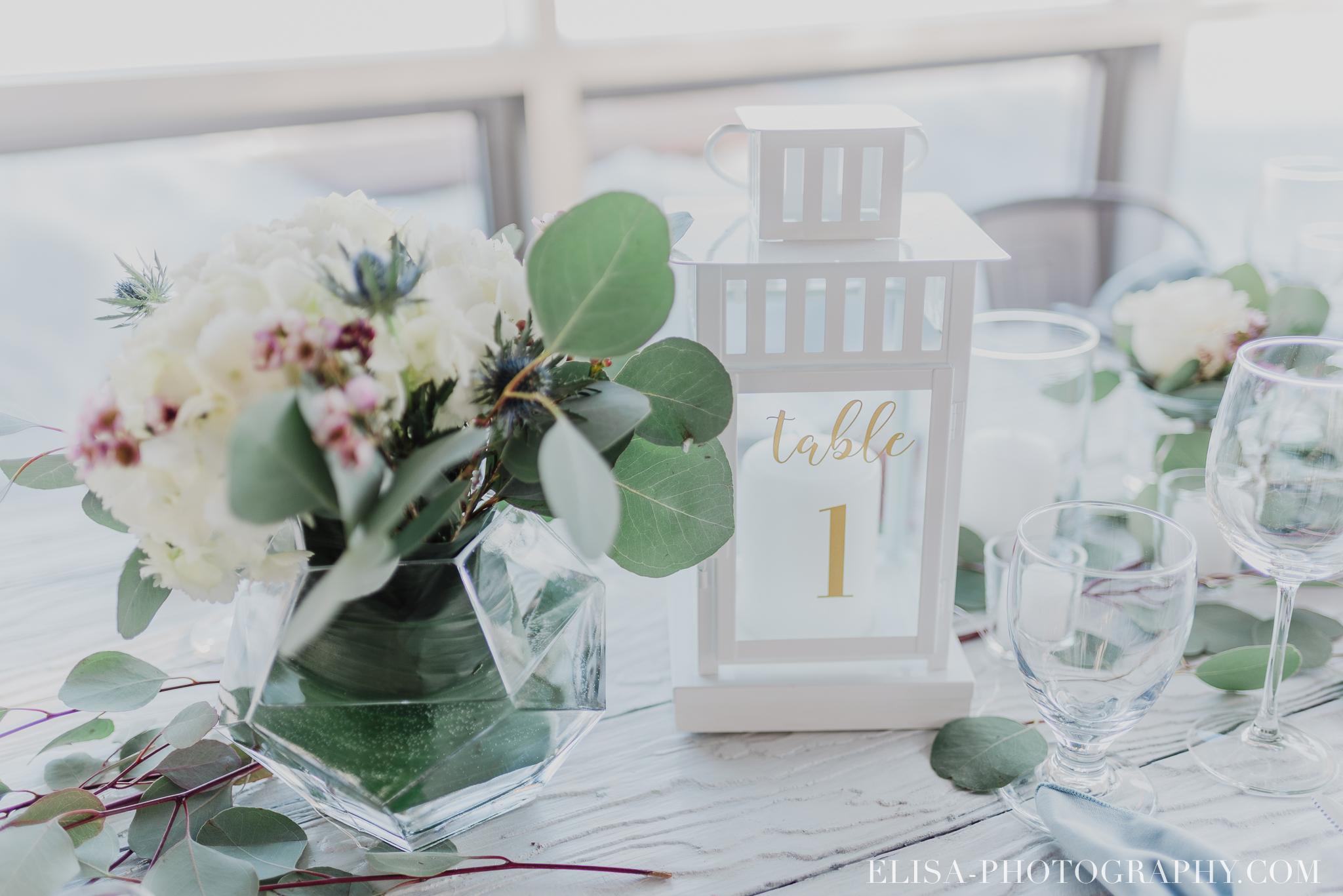 photo mariage hiver salle quai cap blanc port quebec reception centre de table 2800 - Un chaleureux mariage hivernal à la salle du Quai du Cap Blanc, Québec
