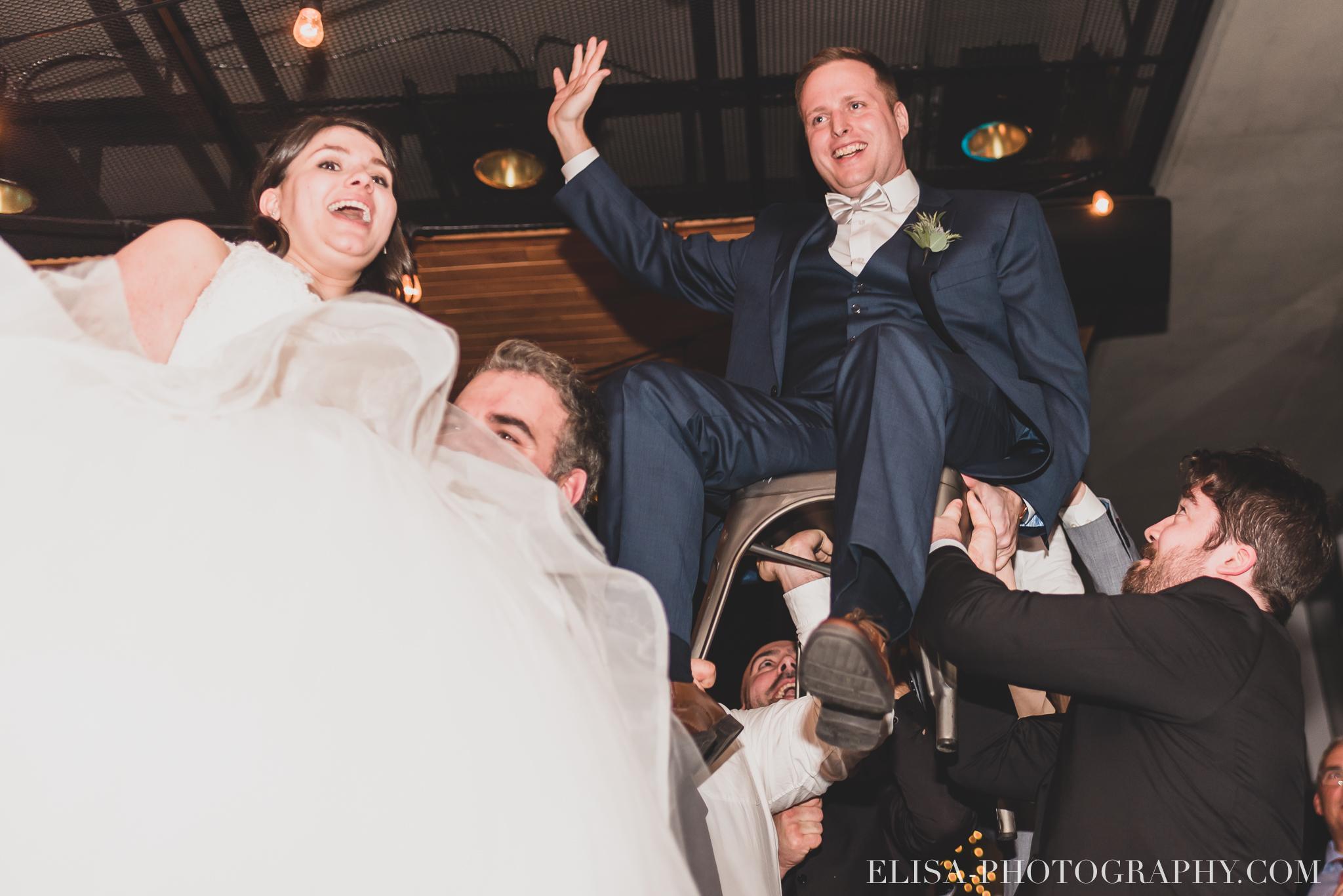 photo mariage hiver salle quai cap blanc port quebec reception danse pere mur lumineux plantes party juif chaises 3831 - Un chaleureux mariage hivernal à la salle du Quai du Cap Blanc, Québec