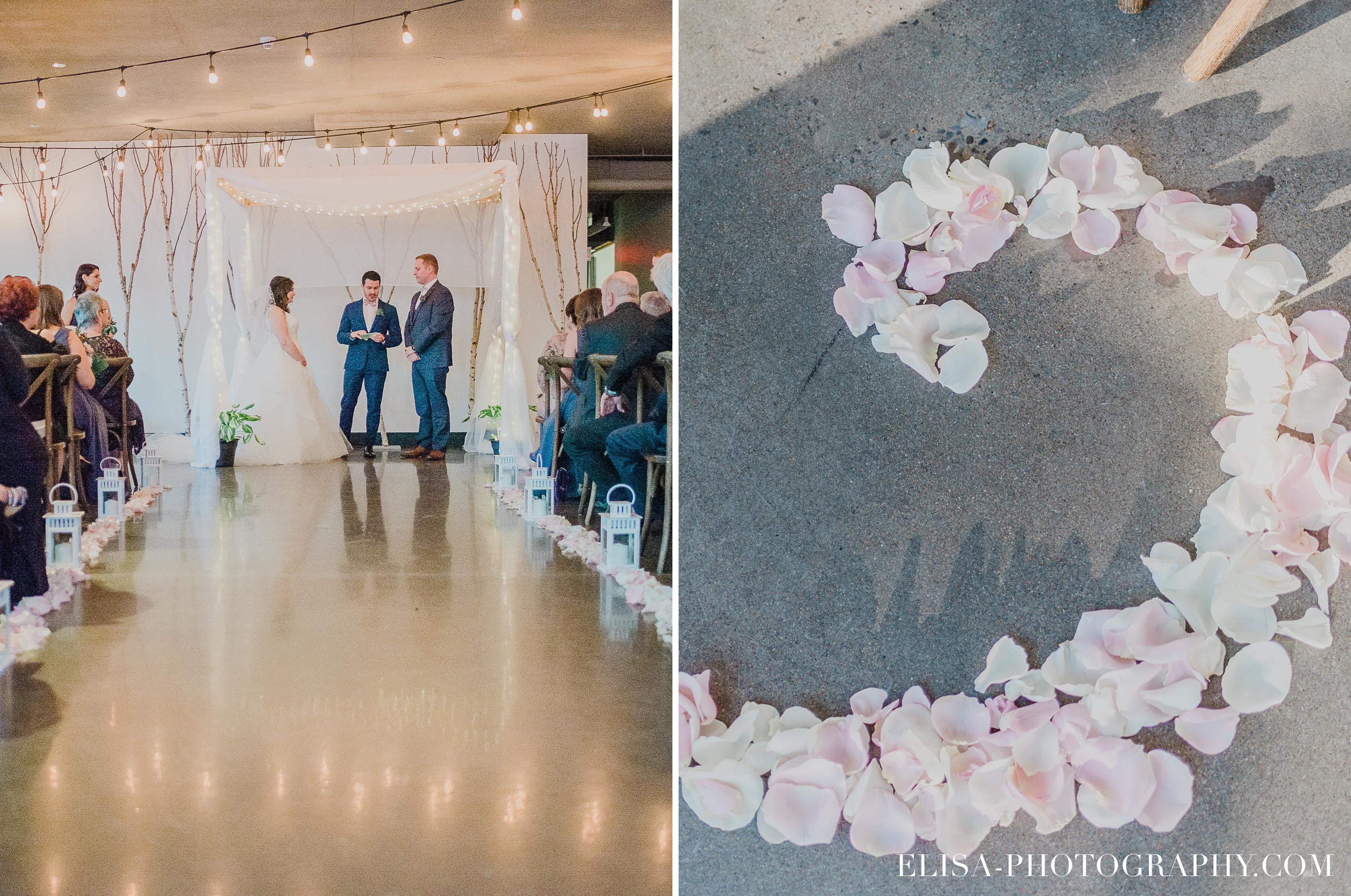 photo mariage quai cap blanc port de quebec ceremonie allee petales rose  - Un chaleureux mariage hivernal à la salle du Quai du Cap Blanc, Québec